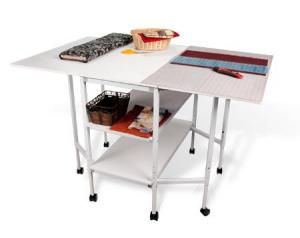 "Grace TrueCut Crafting and Cutting Table on Roller Casters, 8 Sturdy Metal Legs, Fold Down Leaves, Opens to 50x37.4"" Surface, Adjust Height 32"" to 38"""